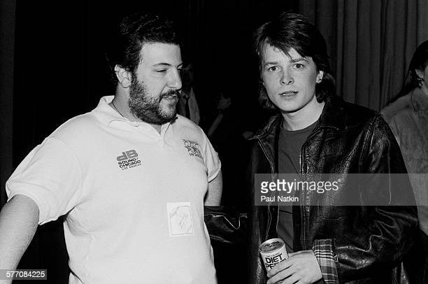 Canadian actor Michael J Fox poses with an unidentified crew member on set at the Thirsty Whale bar during filming of the movie 'Light of Day'...