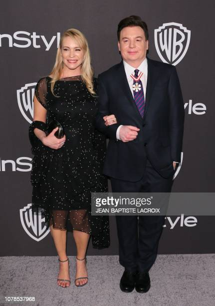 Canadian actor Mike Myers arrives with his wife Kelly Tisdale for the Warner Bros and In Style 20th annual post Golden Globes party at the Oasis...