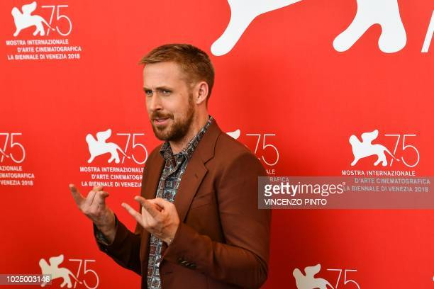 Canadian actor Ryan Gosling gestures during a photocall for the film First Man on August 29 2018 prior to its premiere in competition at the 75th...