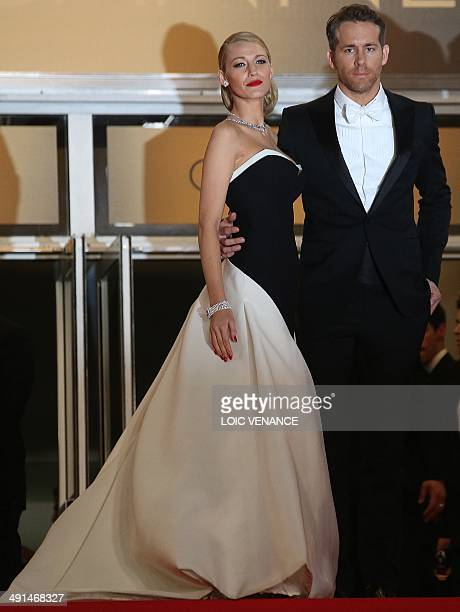 Canadian actor Ryan Reynolds and his wife US actress Blake Lively pose as they arrive for the screening of the film Captives at the 67th edition of...