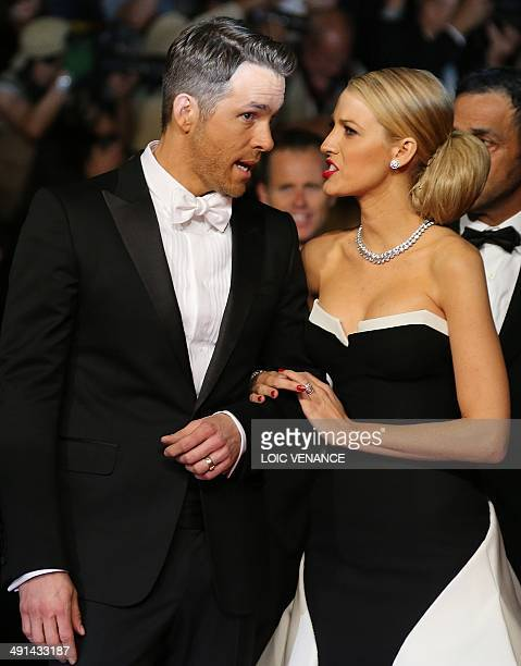 Canadian actor Ryan Reynolds and his wife US actress Blake Lively arrive for the screening of the film Captives at the 67th edition of the Cannes...