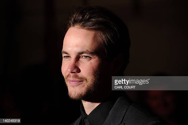 Canadian actor Taylor Kitsch attends the UK premiere of John Carter in central London on March 1 2012 AFP PHOTO/CARL COURT