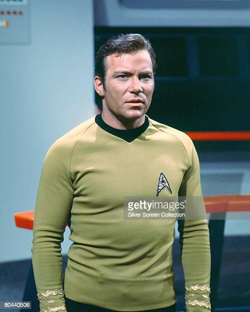 Canadian actor William Shatner as Captain James T. Kirk of the Starship Enterprise in the classic science fiction television series 'Star Trek',...