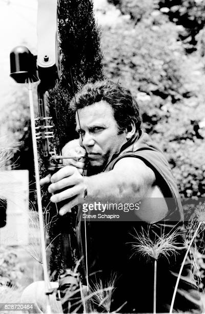 Canadian actor William Shatner draws a compound bow on an archery range at his ranch Three Rivers California 1982