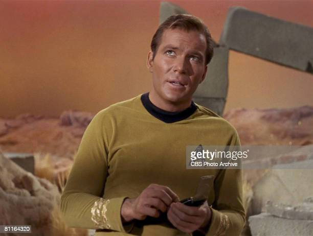 Canadian actor William Shatner glances upwards in a scene from an episode of the television series 'Star Trek' entitled 'The Man Trap,' 1966. The...