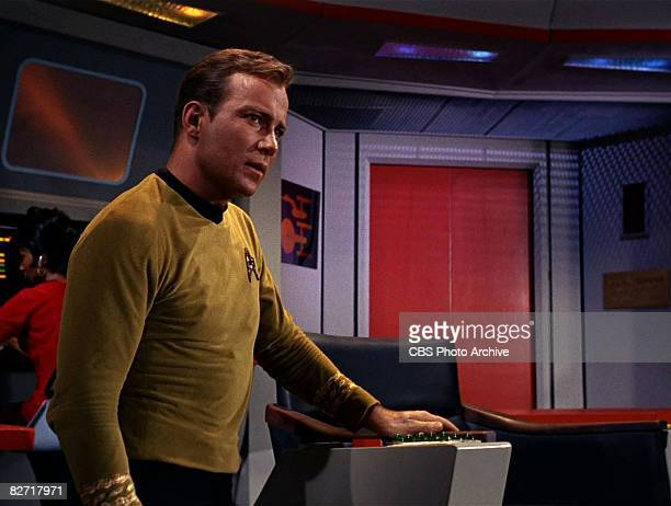 Canadian actor William Shatner sits on the bridge of the USS Enterprise in a scene from 'The Man Trap' the premiere episode of 'Star Trek' which...