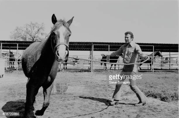 Canadian actor William Shatner trains a horse to circle at his ranch Three Rivers California 1982