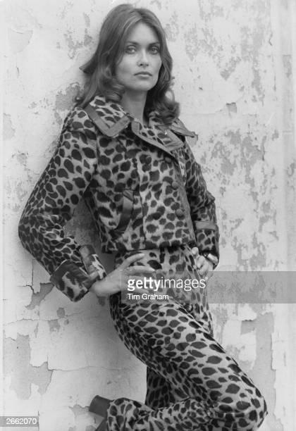 Canadian actress Alexandra Bastedo wearing a leopard skin trouser suit Original Publication People Disc HA0427