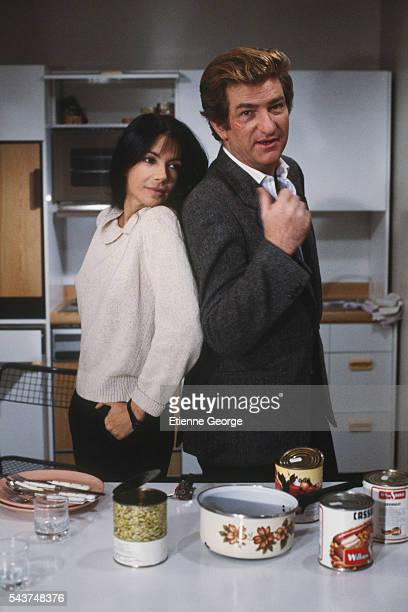 Canadian actress and singer Carole Laure and French actor and singer Eddy Mitchell on the set of A mort l'arbitre directed by JeanPierre Mocky and...