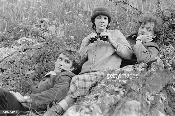 Canadian actress and singer Carole Laure French actors Gerard Depardieu and Patrick Dewaere on the set of Preparez Vos Mouchoirs written and directed...
