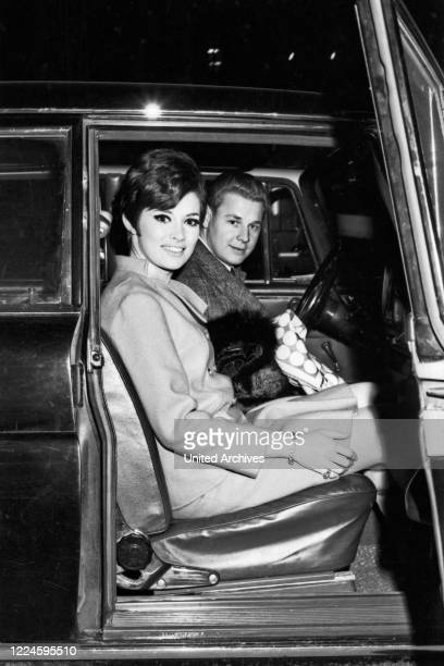 Canadian actress Beverly Adams and driver Otto Maurer at Munich Germany 1960s