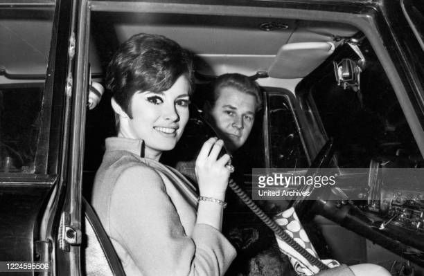 Canadian actress Beverly Adams and driver Otto Maurer in Munich Germany 1960s