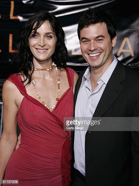 Canadian actress Carrie-Anne Moss wearing a rose Donna Karan Collection chiffon/jersey and tulle dress and husband actor Steven Roy arrive at the...