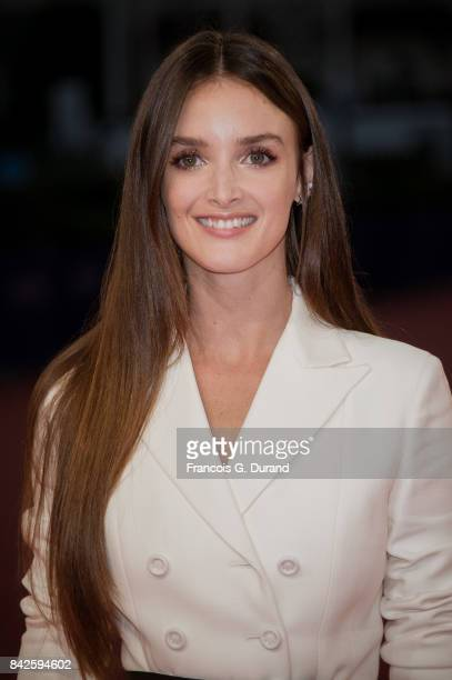 Canadian actress Charlotte Le Bon poses on the red carpet before the screening of the movie 'The Promise' during the 43rd Deauville American Film...