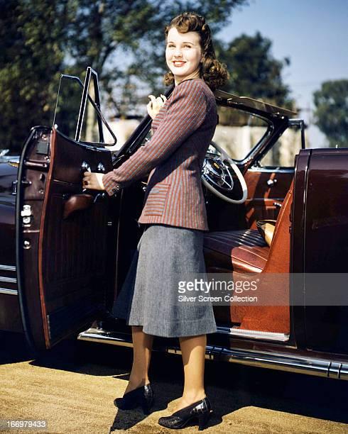Canadian actress Deanna Durbin getting into convertible car circa 1945