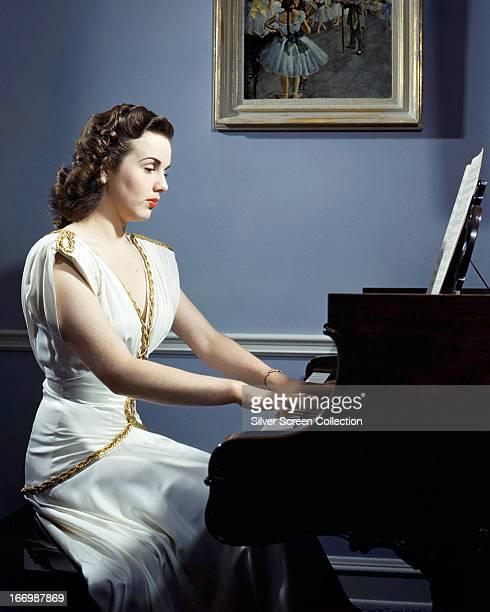 Canadian actress Deanna Durbin playing the piano circa 1945