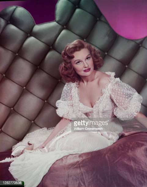 Canadian actress Dianne Foster in a white lace negligee, circa 1955.