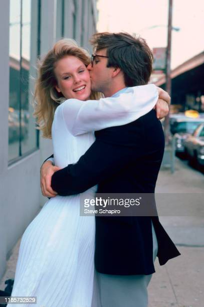 Canadian actress Dorothy Stratten and American actor John Ritter embrace on the set of the film 'They All Laughed' New York New York 1980