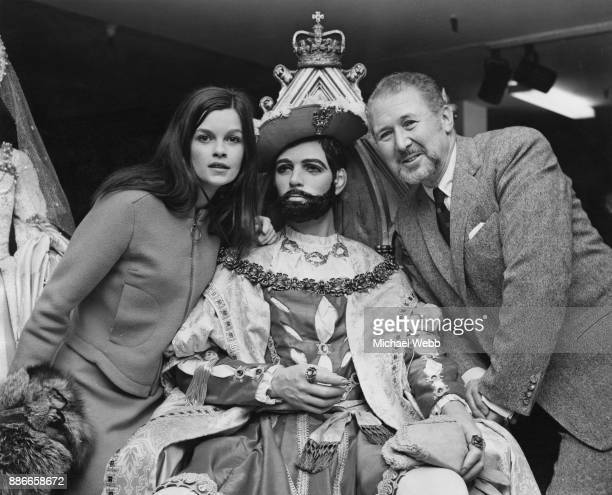 Canadian actress Geneviève Bujold and English actor Anthony Quayle attend an exhibition at Harrods in London of the costumes from the film 'Anne of...