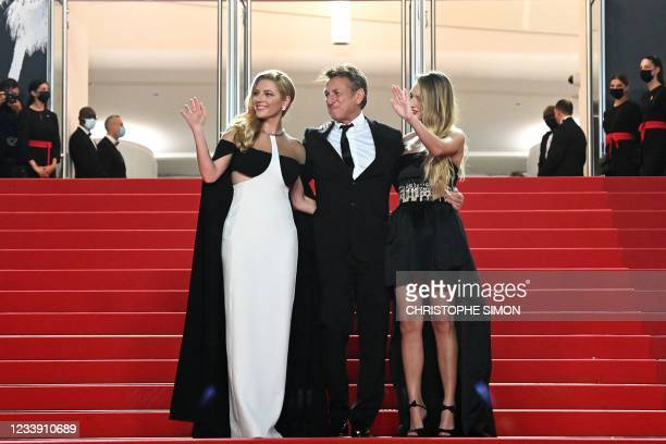 Canadian actress Katheryn Winnick, US actor and director Sean Penn and US actress Dylan Penn wave upon their arrival for the screening of the film...