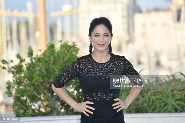 Canadian actress Kristin Kreuk poses for a photograph during the MIPCOM trade show in Cannes southern France on October 16 2017 / AFP PHOTO / YANN...