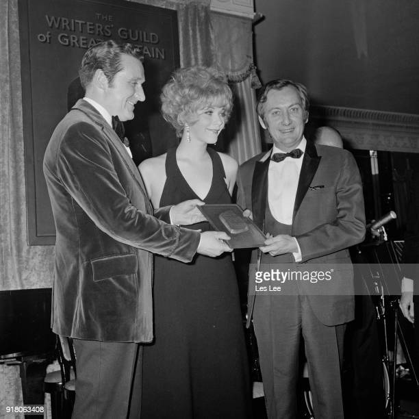 Canadian actress Linda Thorson and British actor Patrick Macnee presents 'Best British Comedy Script' award to British scriptwriter Johnny Speight at...