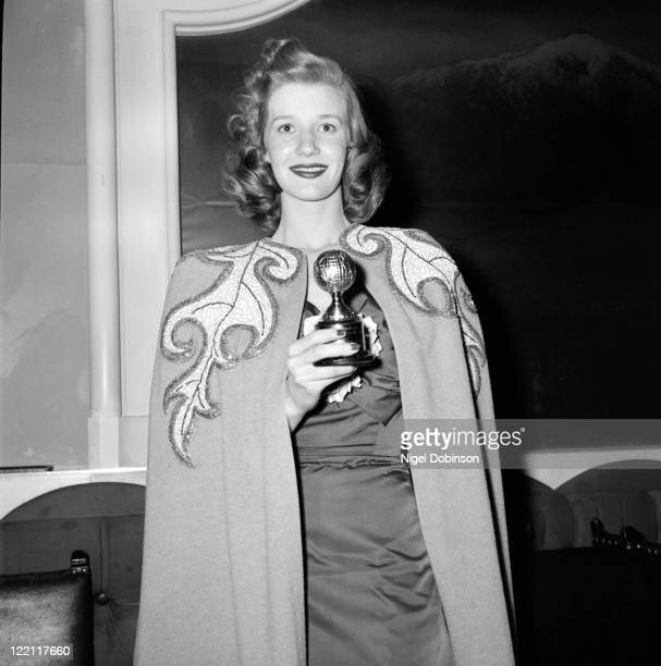 Canadian actress Lois Maxwell with her Golden Globe award for Most Promising Newcomer , Los Angeles, USA, 10th March 1948. She won the award for her...