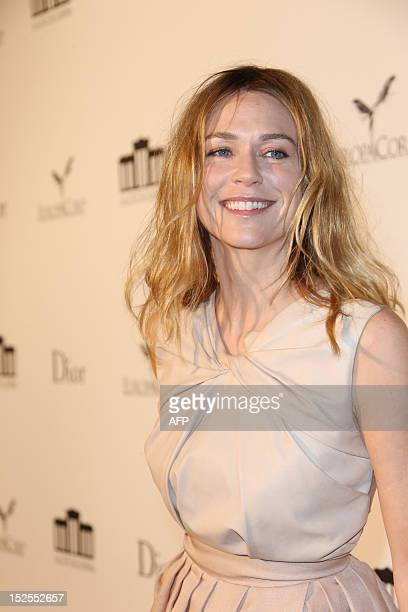 Canadian actress MarieJosee Croze poses as she arrives to attend the inauguration ceremony of the Cite du cinema a film studios complex heralded as...