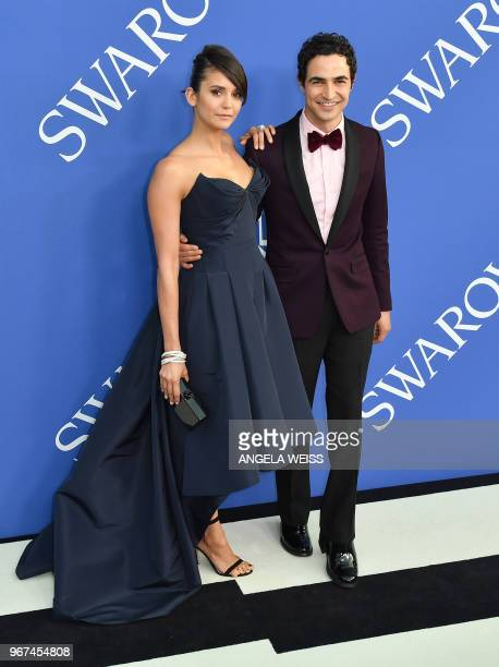 Canadian actress Nina Dobrev and US fashion designer Zac Posen arrive at the 2018 CFDA Fashion awards June 4 2018 at The Brooklyn Museum in New York