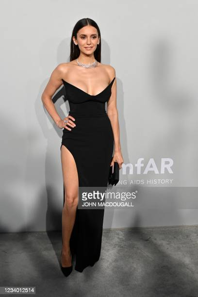 Canadian actress Nina Dobrev arrives on July 16, 2021 to attend the amfAR 27th Annual Cinema Against AIDS gala at the Villa Eilenroc in Cap...
