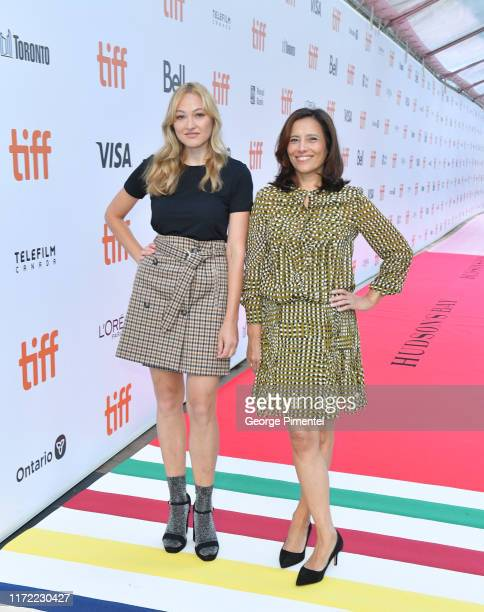 Canadian Actress Olivia Scriven and TIFF Executive Director Joana Vicente attend Hudson's Bay Rolls Out of The Striped Carpet For Toronto...