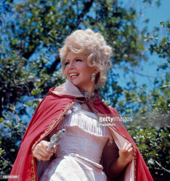 Canadian actress Ruta Lee posed holding a revolver on the set of the television series 'The Wild Wild West' in 1968