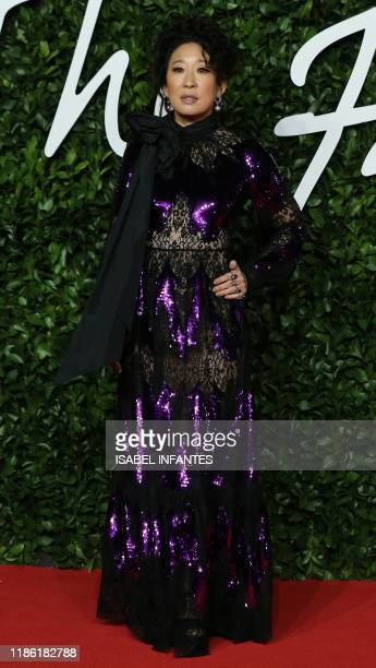 Canadian actress Sandra Oh poses on the red carpet upon arrival at The Fashion Awards 2019 in London on December 2 2019 The Fashion Awards are an...