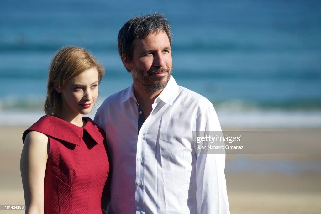 Canadian actress Sarah Gadon (L) and Denis Villeneuve attend 'Enemy' photocall at Kursaal on September 21, 2013 in San Sebastian, Spain.