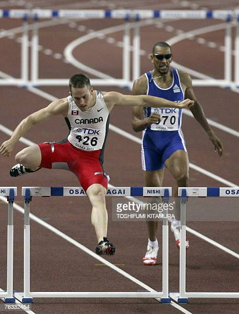 Canadian Adam Kunkel competes during the mens 400m hurdles at the 11th IAAF World Athletics Championships in Osaka 26 August 2007 AFP PHOTO TOSHIFUMI...