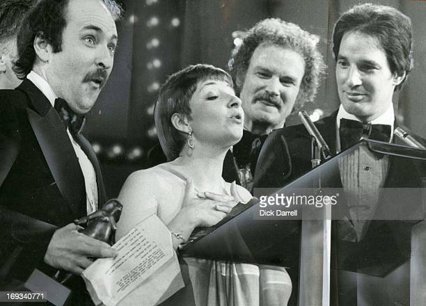 AWARDS APRIL 14 1979 Canadian Air farce receive their ACTRA for Best Radio Variety Performance From left Roger Abbott Luba Goy Dave Broadfoot and Don...