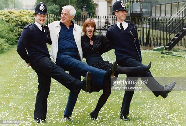 Canadian American actor and comedian Leslie Nielsen dancing with actress Priscilla Presley and two policemen UK 1994 Nielsen and Presley starred...