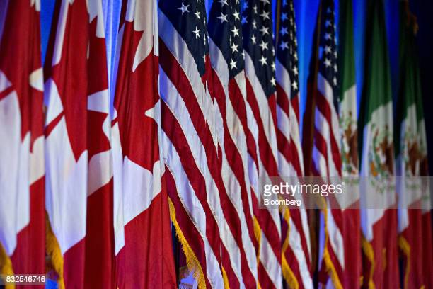 Canadian American and Mexican flags stand on stage ahead of the first round of North American Free Trade Agreement renegotiations in Washington DC US...