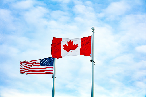 Canadian and American flag together 1131716095