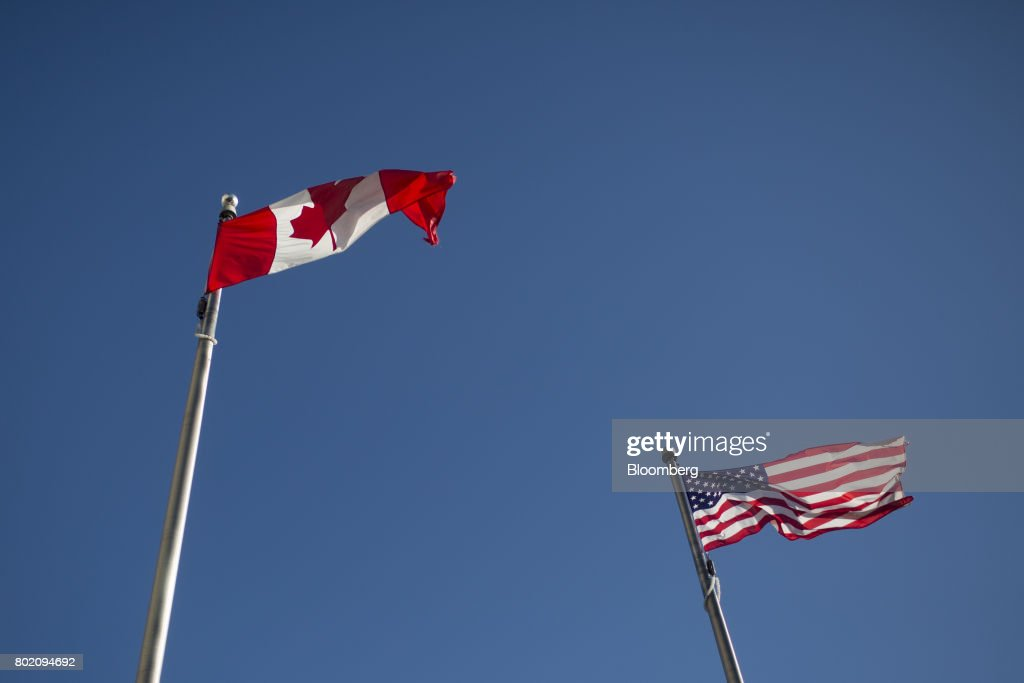 Canadian and American flags fly at the Niagara Falls