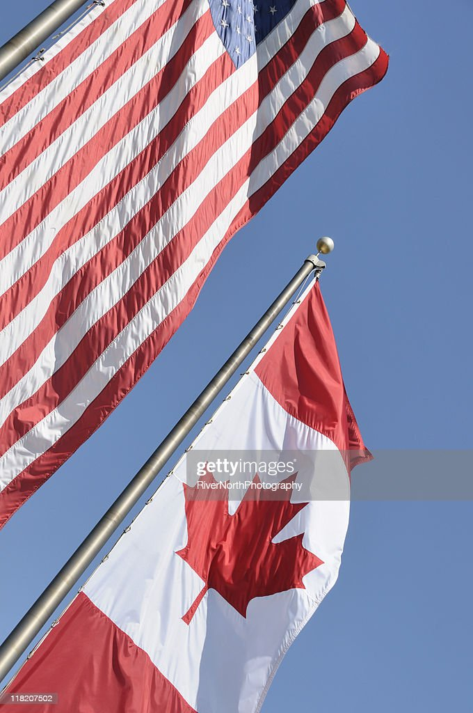 dd329f4f9d7 Canadian and American Flags   Stock Photo