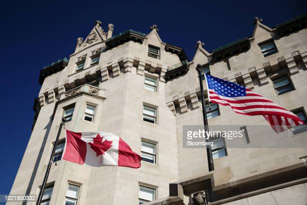 A Canadian and an American flag fly outside the Fairmont Hotels Resorts Inc Chateau Laurier hotel in Ottawa Ontario Canada on Thursday Aug 16 2018 It...