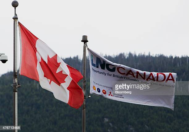 Canadian and LNG Canada flags fly outside of the company's office in Kitimat British Columbia Canada on Friday June 5 2015 Canadian stocks rose a...