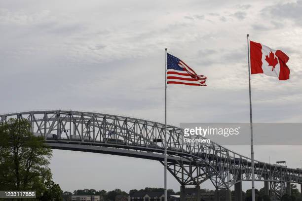 Canadian and U.S. Flags fly at the base of the Bluewater Bridge, which connects Canada and the U.S., near the Enbridge Line 5 pipeline in Sarnia,...