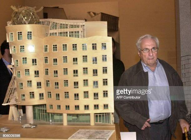 Canadian architect Frank Gehry walks past a 3D model of the building in Prague housing Dutch insurance company National Nederlanden 30 October 2001...