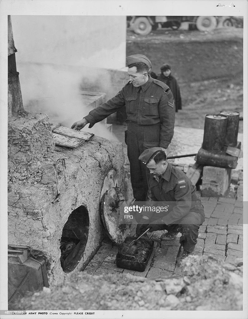 Canadian army cooks using a makeshift oven, made from scrap metal