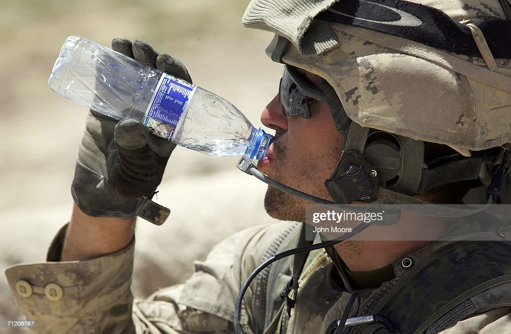 A Canadian army soldier drinks water in sweltering heat while conducting a sweep operation for Taliban fighters June 14, 2006 in Panjwai, 30 kilometers southwest of Kandahar, Afghanistan. The Canadians, along with American and British forces, are part of Operation Mountain Thrust, which is the largest anti-Taliban operation since 2001. The offensive spans across southern Afghanistan and should last through the summer.
