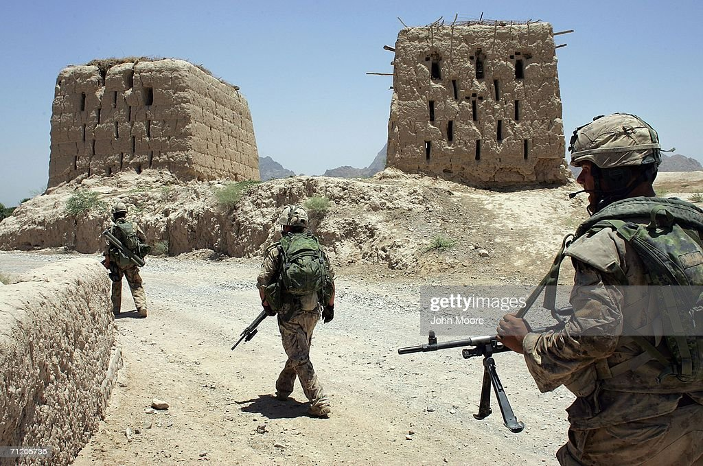 Canadian army soldiers conduct a sweep operation for Taliban fighters on June 14, 2006 in Panjwai, 30 kilometers southwest of Kandahar, Afghanistan. The Canadians, along with American and British forces, are part of Operation Mountain Thrust, which is the largest anti-Taliban operation since 2001. The offensive spans across southern Afghanistan and should last through the summer.