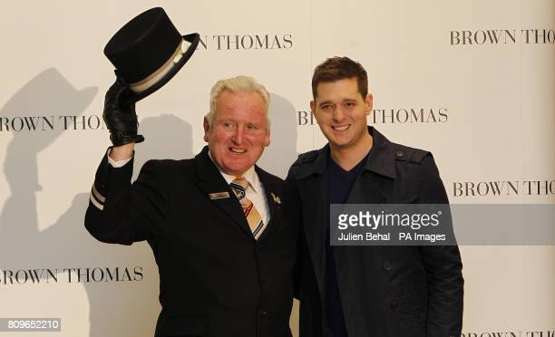 Canadian artist Michael Buble poses with Brown Thomas doorman Ciaran Bass in the famous Dublin department store during his visit to Dublin to promote...