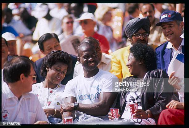 Canadian athlete Ben Johnson and his family watch the women's 100m event at the 1988 Seoul Summer Olympic Games